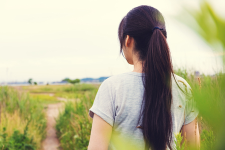Photo for Woman looking out at the path that lies ahead - Royalty Free Image