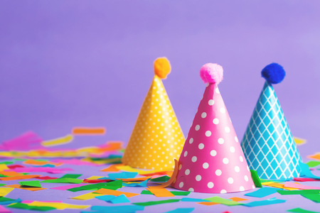 Photo for Party hat celebration theme with confetti on a bright background - Royalty Free Image