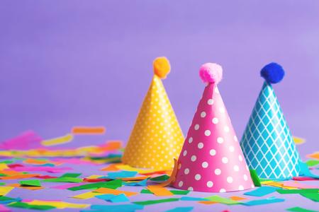 Foto de Party hat celebration theme with confetti on a bright background - Imagen libre de derechos
