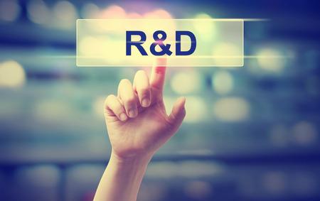 Foto de R and D concept with hand pressing a button - Imagen libre de derechos