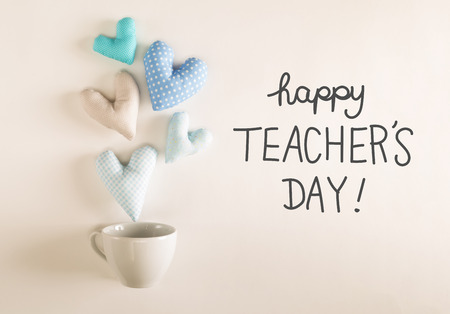 Photo pour Teachers Day message with blue heart cushions coming out of a coffee cup - image libre de droit