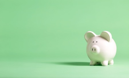 Photo pour White piggy bank with glasses on a muted green background - image libre de droit