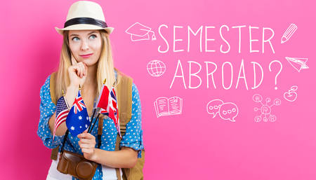 Foto de Semester Abroad text with young woman with flags of English speaking countries - Imagen libre de derechos