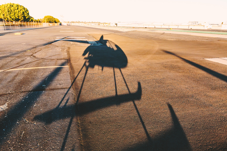 Foto de Shadow of a helicopter at an airport - Imagen libre de derechos