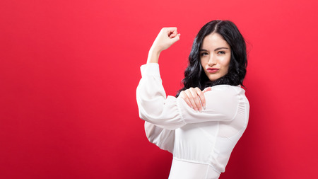 Photo for Powerful young woman a solid color background - Royalty Free Image