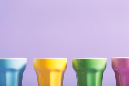 Foto de Little cups aligned on a bright background - Imagen libre de derechos