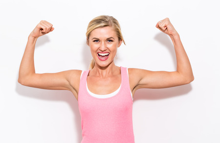 Foto per Powerful young fit woman on a white background - Immagine Royalty Free