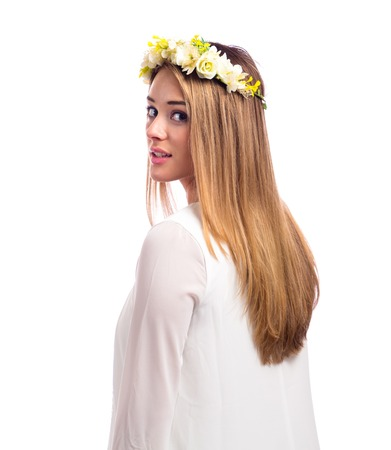 Photo pour Beautiful young woman with a flower garland and a white dress isolated on a white background - image libre de droit