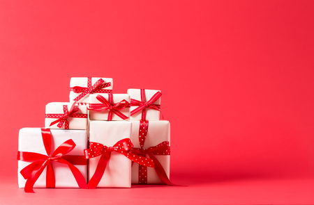 Photo pour Collection of Christmas present boxes on a red background - image libre de droit