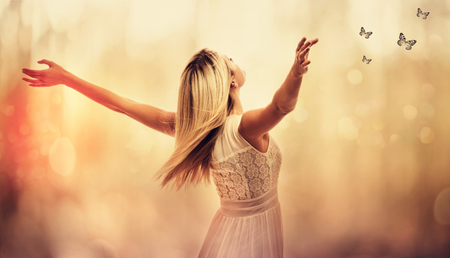 Photo for Beautiful woman standing with arms wide open - Royalty Free Image
