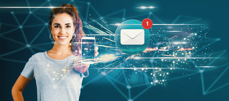 Foto de Email with young woman holding out a smartphone in her hand - Imagen libre de derechos