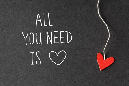 Foto de All You Need Is Love message with handmade small paper hearts - Imagen libre de derechos