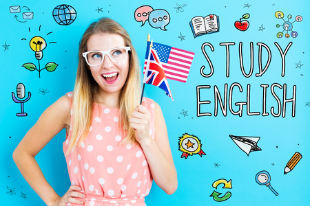 Foto de Study English theme with young woman holding flags - Imagen libre de derechos