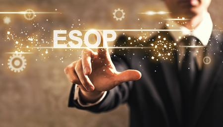 Photo pour ESOP text with businessman on dark vintage background - image libre de droit