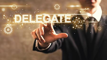 Foto de Delegate text with businessman on dark vintage background - Imagen libre de derechos