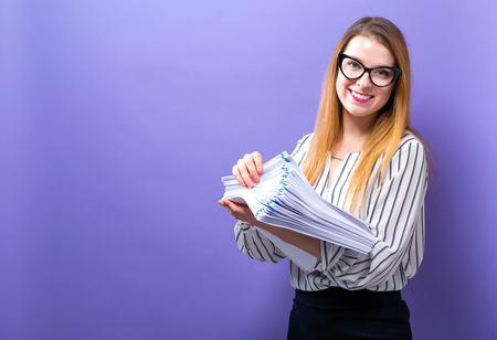 Photo for Office woman with a stack of documents on a solid background - Royalty Free Image