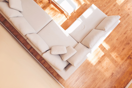 Foto de White sectional couch in a large luxury interior home - Imagen libre de derechos