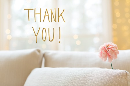 Foto für Thank You message with a flower in a bright interior room sofa - Lizenzfreies Bild
