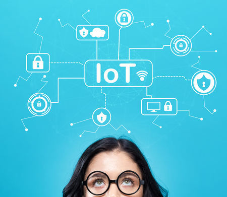 Foto de IoT security theme with young woman on a blue background - Imagen libre de derechos