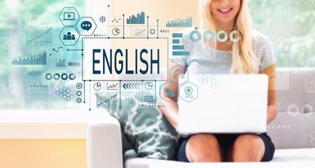 Foto de English with young woman using a laptop computer - Imagen libre de derechos