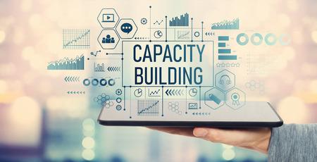 Foto de Capacity building with man holding a tablet computer - Imagen libre de derechos