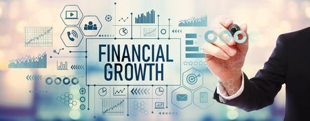 Foto de Financial growth with businessman on blurred abstract background - Imagen libre de derechos