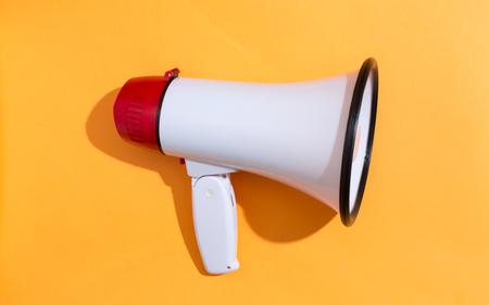 Photo pour A big megaphone on a orange background - image libre de droit