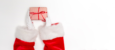 Foto de Santa holding a Christmas gift on a white background - Imagen libre de derechos