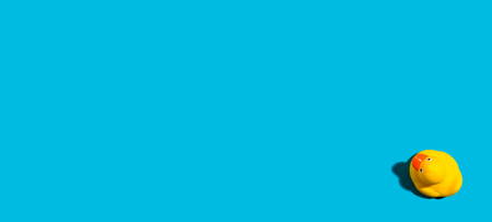 Photo for One yellow rubber duck on a blue background - Royalty Free Image