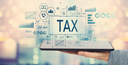 Photo pour Tax with man holding a tablet computer - image libre de droit