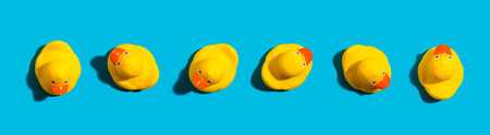 Photo for Collection of yellow rubber ducks on a blue background - Royalty Free Image