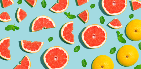 Photo for Halved fresh grapefruits on bright color background - Royalty Free Image