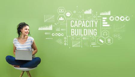 Foto de Capacity building with young woman using a laptop computer - Imagen libre de derechos
