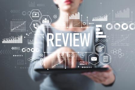 Photo pour Review with business woman using a tablet computer - image libre de droit