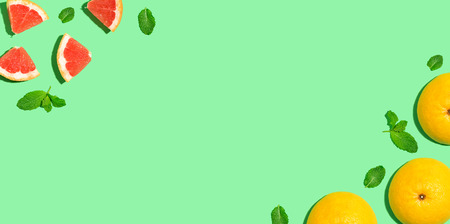 Photo for Fresh grapefruits on a bright color background - Royalty Free Image