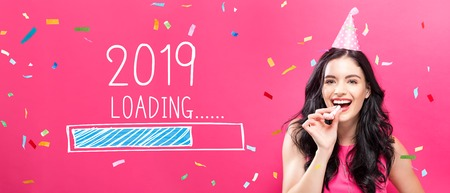 Photo pour Loading new year 2019 with young woman with party theme on a pink background - image libre de droit