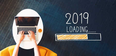Photo pour Loading new year 2019 with person using a laptop on a white table - image libre de droit