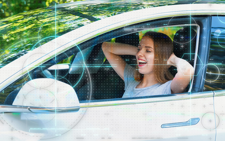 Foto per Young woman in a self-driving autonomous electric car - Immagine Royalty Free