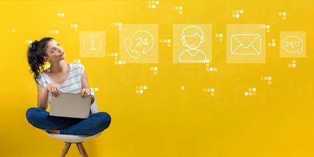 Foto de Customer service 24 hours 7 days a week with young woman using a laptop computer - Imagen libre de derechos