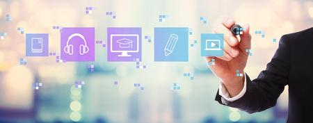 Foto de E-Learning with businessman on blurred abstract background - Imagen libre de derechos