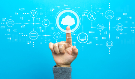 Foto de Cloud computing with hand on a blue background - Imagen libre de derechos