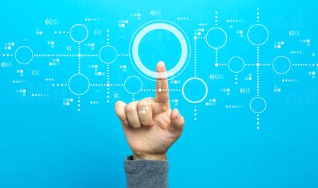 Foto de Connected circles chart with hand on a blue background - Imagen libre de derechos