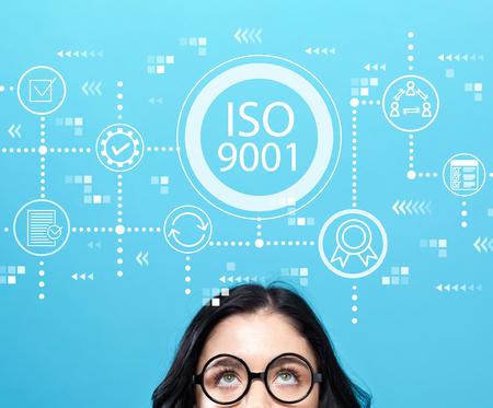 Foto de ISO 9001 with young woman wearing eye glasses - Imagen libre de derechos
