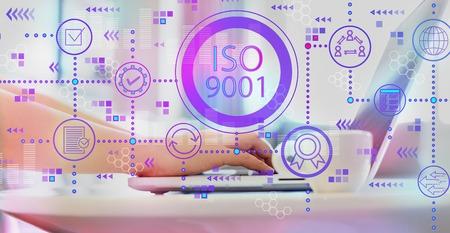 Foto de ISO 9001 with woman using a laptop on a coffee table - Imagen libre de derechos