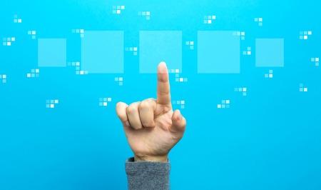 Foto de Digital square boxes with hand on a blue background - Imagen libre de derechos