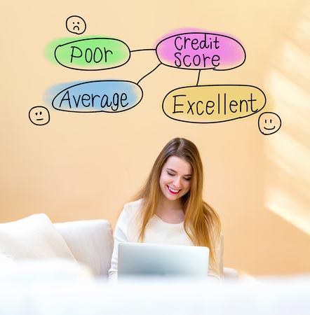 Foto de Credit score theme with young woman using her laptop computer at home - Imagen libre de derechos