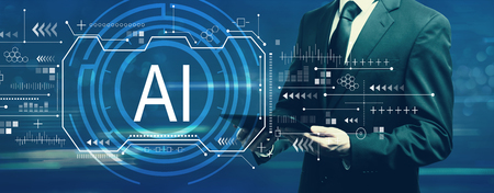 Foto de AI concept with businessman holding a tablet computer - Imagen libre de derechos