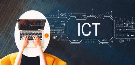 Foto de Information and communications technology with person using a laptop on a white table - Imagen libre de derechos