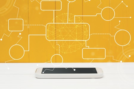 Foto de Flowchart with smartphone on yellow wooden background - Imagen libre de derechos