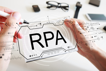 Foto per Robotic process automation concept with man writing in a notebook - Immagine Royalty Free